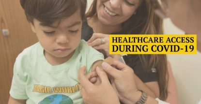 Health care practitioner affixing bandage to Hispanic child while his mother looks on