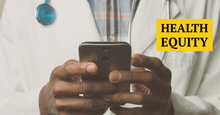 Black doctor checking his phone